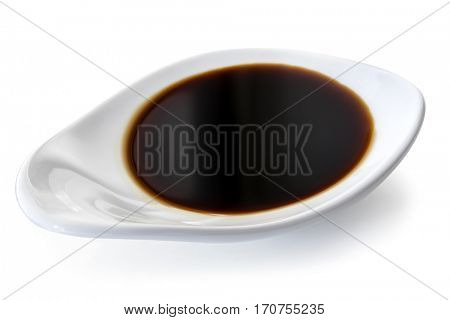 Dish of soy sauce, isolated on white.