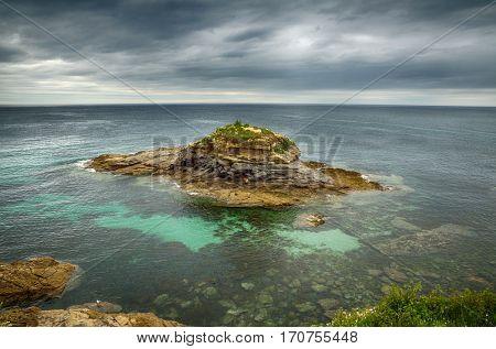 Ocean coast in the north west of Spain, Galicia region, cliffs in Foz town