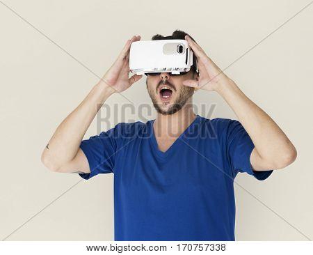 A man using a visualizing reality gadget