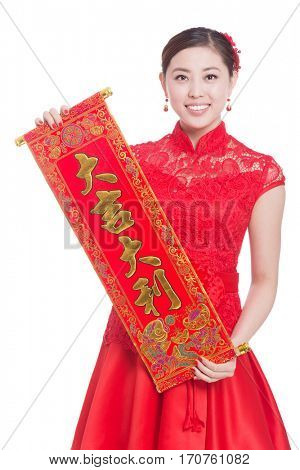 young asian woman in red cheongsam holds red couplet in chinese new year. Chinese words means to celebrate everyone good lucky and healthy in coming year