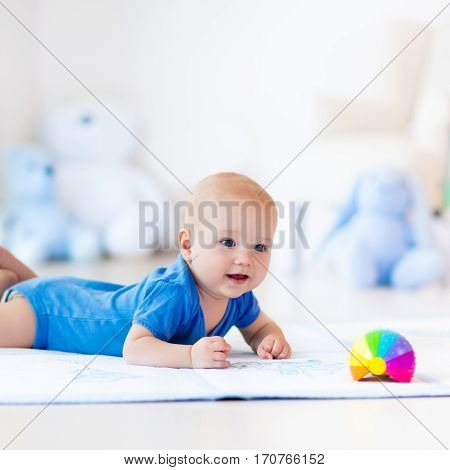 Baby Boy Playing With Toy Ball