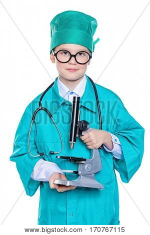 Cute smiling boy dressed like a doctor holding a microscope. Different occupations. Pediatrics. Isolated over white.