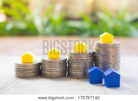 Business investment growth conceptsaving conceptsaving for house conceptpay by instalmentsbuy the housebuy the house wood and green background