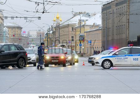 Moscow, Russia - December, 19, 2017: The police officer regulates the movement in the center of Moscow on crossing of streets Sadovoye Koltso (Garden ring) and Prospect Mira (Peace Avenue)