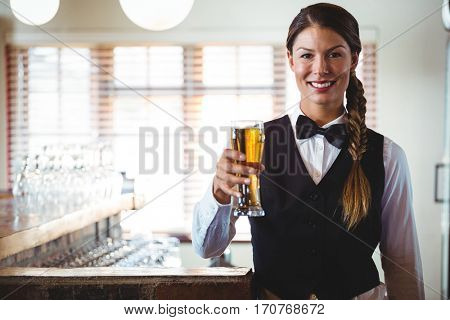Waitress holding a beer in a restaurant