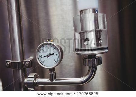 Close-up of pressure gauge on storage tank in brewery
