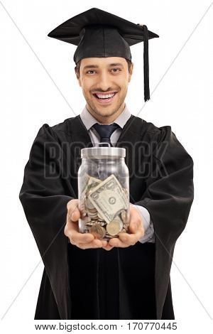 Happy graduate student with a jar filled with money isolated on white background