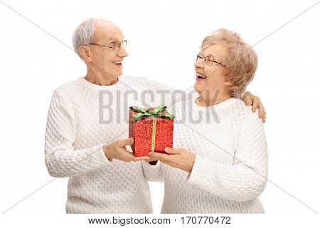 Cheerful elderly couple exchanging gifts isolated on white background