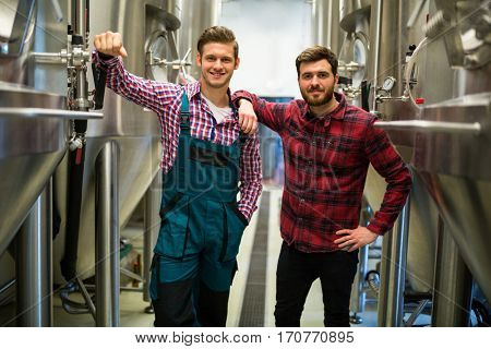 Portrait of brewers with arms crossed at brewery