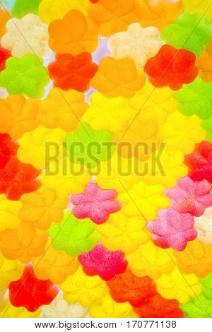 Jujube in sugar absence star shape colorful abstract texture background back light closeup