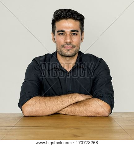 Adult guy sitting arm crossed
