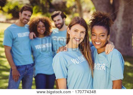 Portrait of volunteer group having fun in park