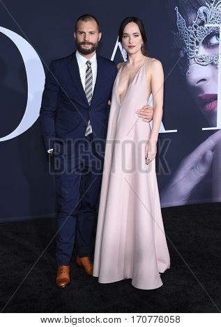 LOS ANGELES - FEB 02:  Jamie Dornan and Dakota Johnson arrives to the