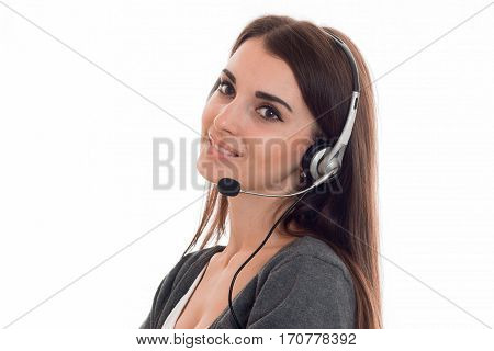 cutie young brunette call office worker woman with headphones and microphone smiling isolated on white