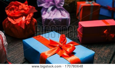 Colorful papered and ribboned gift boxes. Close-up wide angle view