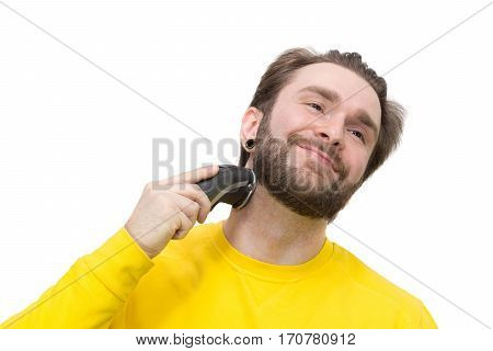 The photo depicts a man shaving beard
