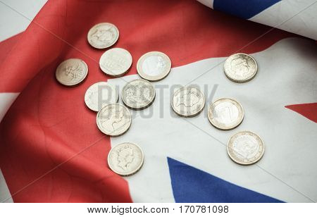 pound coins money (GBP), currency of United Kingdom, over the Union Jack