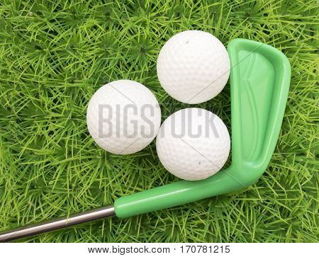 About Learning The Game Of Golf Colored Putter And Golf Ball On Green Grass