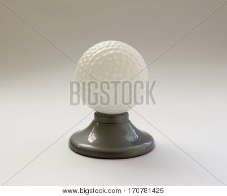 Golf Ball On A Stand On White Background