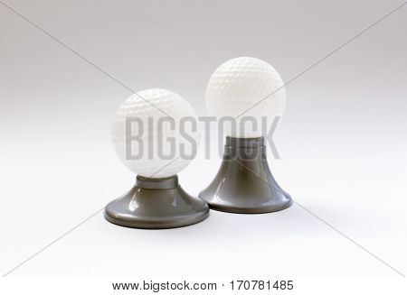 Golf Balls Toy Set On A Stand On White Background