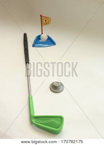 Toy Golf Shot Into The Hole With A Stick Iron