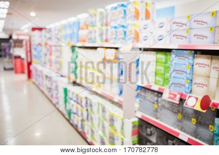 Focus on foreground of an aisle in a supermarket