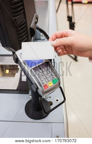Close up of payment by credit card without contact