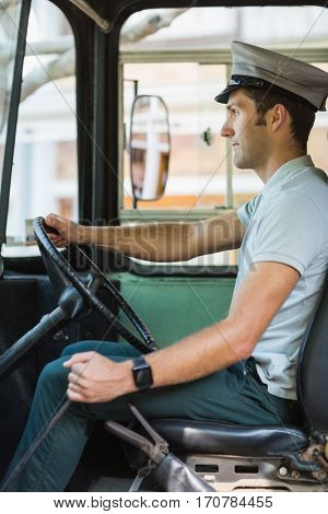 Confident bus driver driving a bus