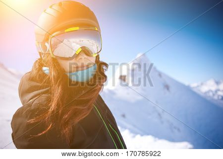 Woman in helmet among mountains