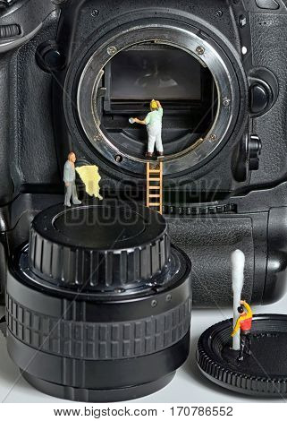 Camera sensor cleaning by figurines