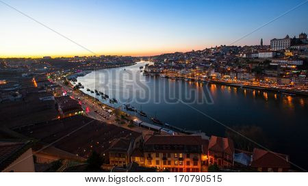 View over the Douro river by night, Porto, Portugal.