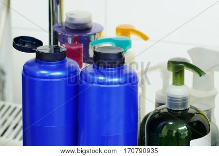The bottles with shampoo and other perfume