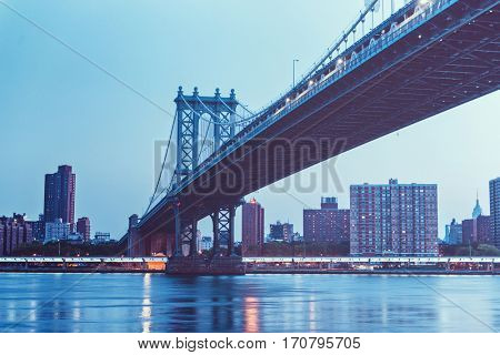 Low light long exposure view of bottom of Manhattan bridge from Brooklyn side of river - New York