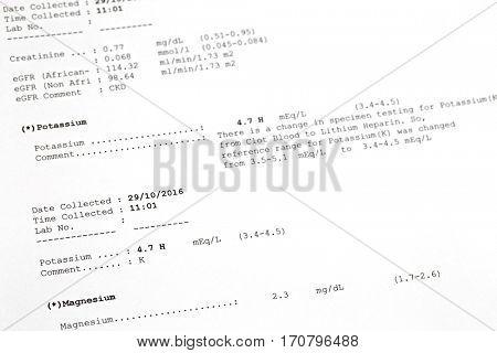 Soft focus of printed result paper of Potassium, Magnesium Levels in Blood. Lab test for potassium, magnesium deficiency.