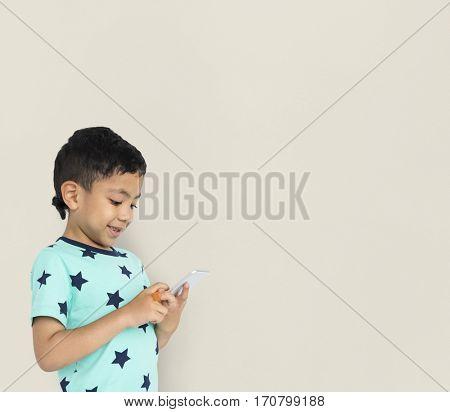 Little boy studio isolated with phone