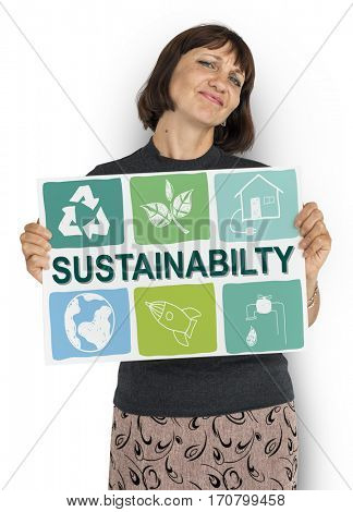 Woman holding sustainability environment board