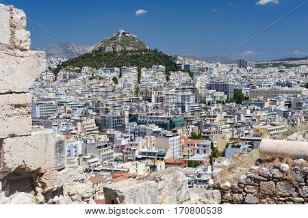 Athens Greece - April 27, 2016: Famous view from Acropolis to modern city with Lycabettus hill at background