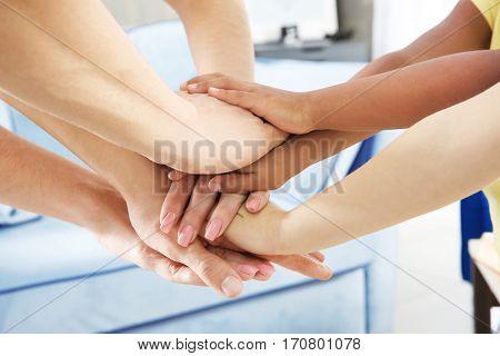 United hands closeup. Family concept