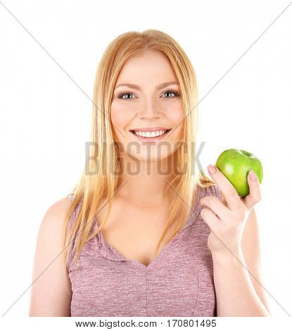 Young woman holding apple on white background