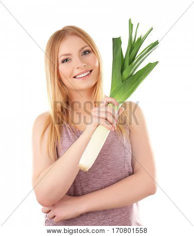 Young woman holding leek on white background