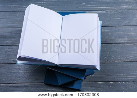 Opened book on grey wooden background