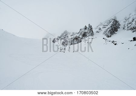 View Of A Ski Slope In Cloudy Mountains