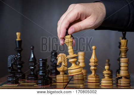 Game in chess. The chess player makes the move