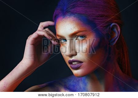 Portrait of sensual young woman with amazing body-art
