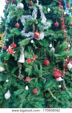 Christmas tree ornaments on tree. Outdoor Christmas decorations