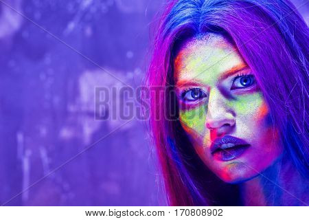 Portrait of attractive young woman with amazing body-art, closeup
