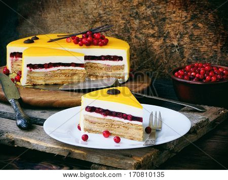 Piece Of Cake Covered With A Mirror Coating, Decorated With Cranberries And Chocolate Decor. Modern