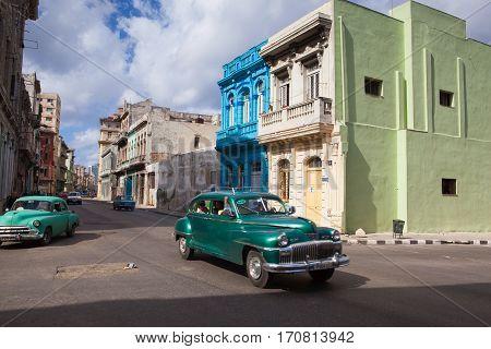Havana Cuba - January 22 2017: Decaying and renovated buildings on the main street in Old Havana City Cuba