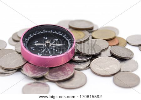 compass and coins on white background, closeup