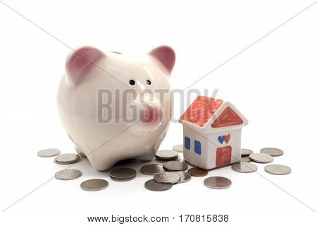piggy bank with house and coin on white background
